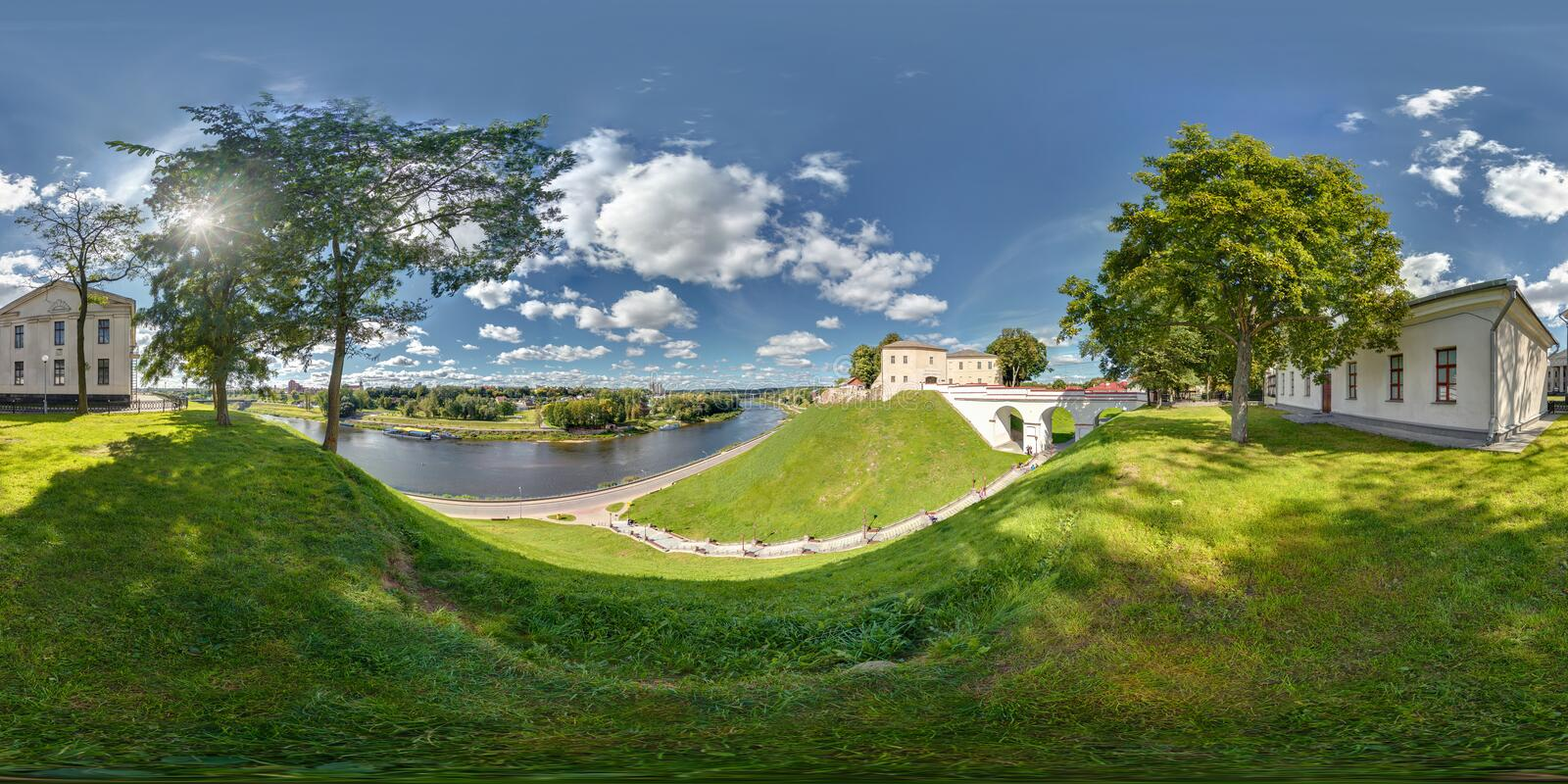 Full 360 degree panorama in equirectangular equidistant spherical projection on the ruins of an ancient medieval castle over the. River neman in sunny day royalty free stock photography