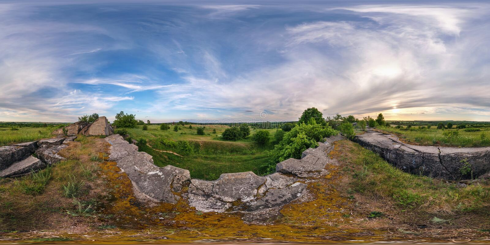Full 360 degree seamless panorama in equirectangular spherical equidistant projection. Panorama near abandoned fortress of the. First World War at sunset stock image