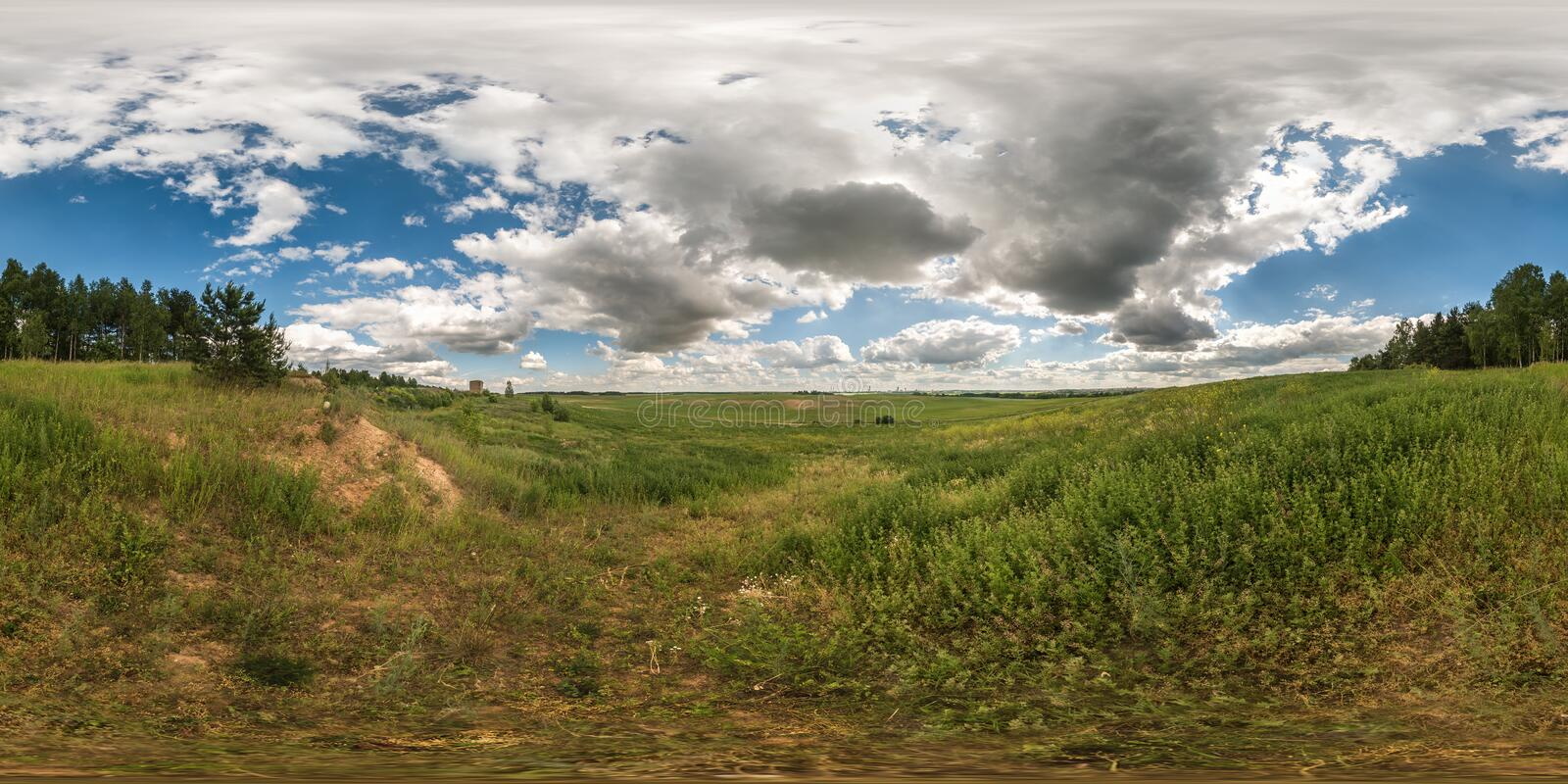 Full 360 degree seamless panorama in equirectangular spherical equidistant projection. Panorama view in a field in beautiful day. With nice clouds. Background stock images