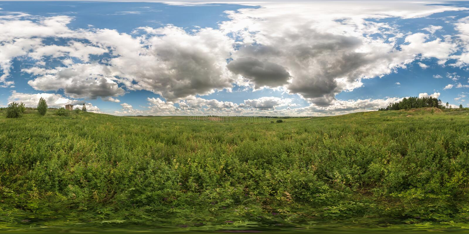 Full 360 degree seamless panorama in equirectangular spherical equidistant projection. Panorama view in a meadow in beautiful day. With nice clouds. Background stock photo