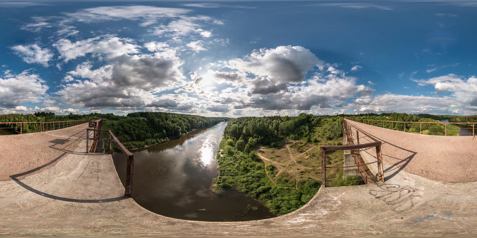 Full 360 degree seamless panorama in equirectangular spherical equidistant projection. Panorama view on abandon bridge near river. With nice clouds. Skybox as royalty free stock photography