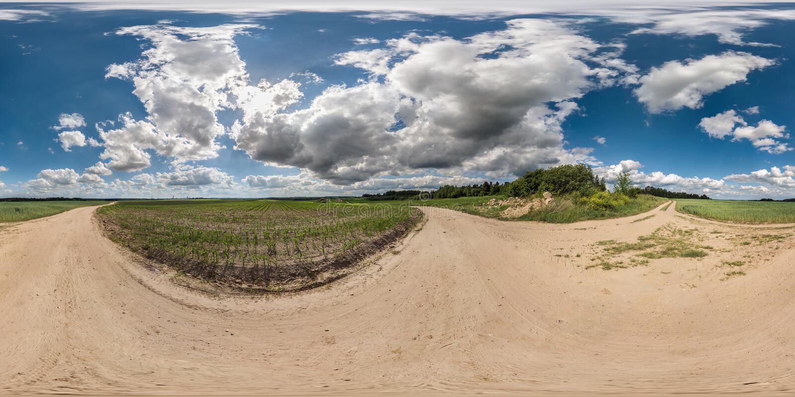Full 360 degree seamless panorama in equirectangular spherical equidistant projection. Panorama view on the road with beautiful. Day and awesome clouds royalty free stock photography