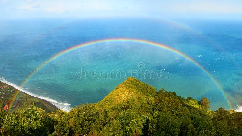 Full double rainbow with ocean in behind, Madeira royalty free stock image