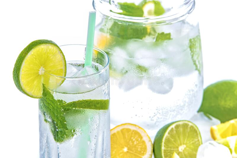 Full Drinking Glass With Slice of Lime royalty free stock images