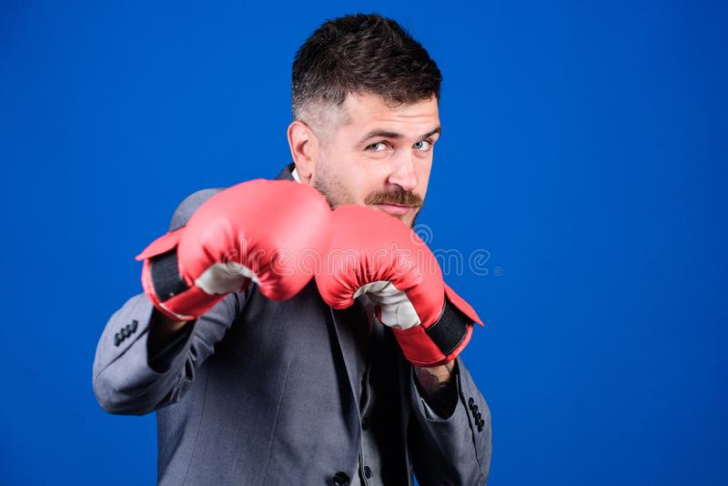 Full of energy. bearded man in boxing gloves punching. Business and sport success. powerful man boxer ready for stock photos