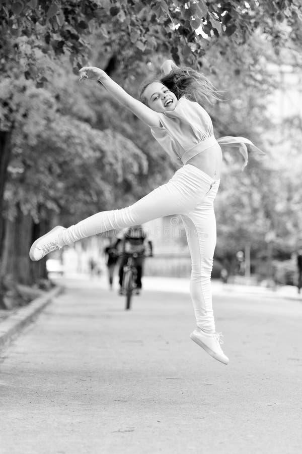 Full of energy. Girl carefree child. Kid long hair enjoy walking. Little child enjoy walk. Health, good mood and royalty free stock photo
