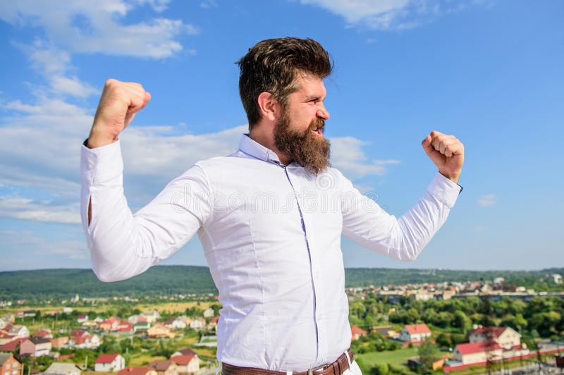 Full of energy. Man bearded hipster feels powerful and full of energy when reached top achievement. Man emotional enjoy royalty free stock images