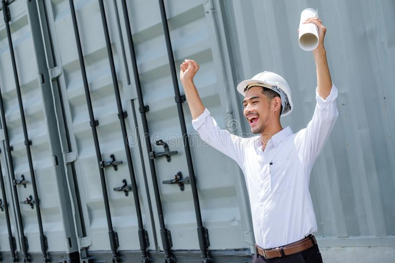 Full energy. Pleasant emotional handsome architect rising his royalty free stock photo
