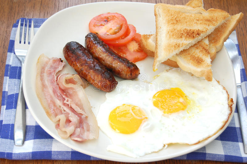 Full english breakfast. Traditional english fried breakfast with sausages and eggs stock photo