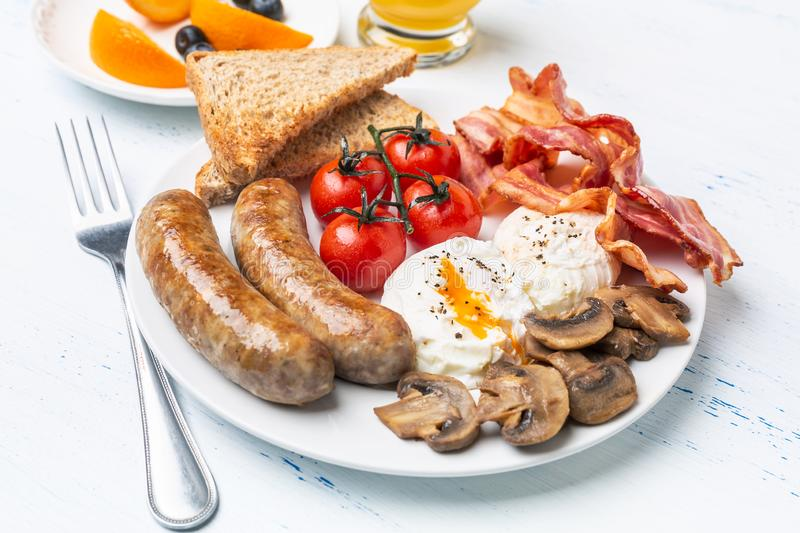 Full English Breakfast with Poached Eggs royalty free stock image