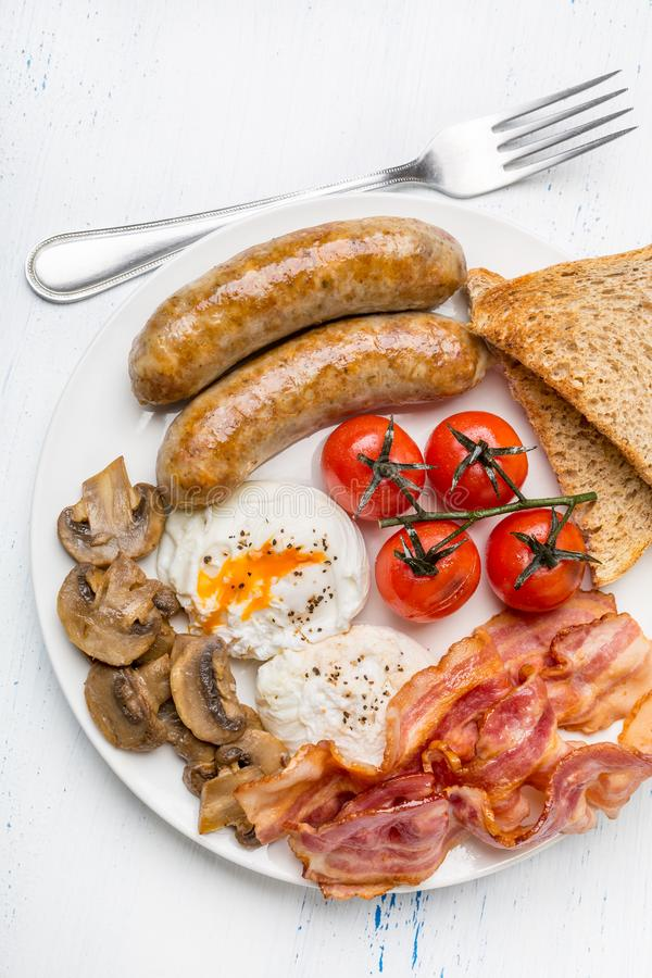 Full English Breakfast with Poached Eggs royalty free stock photo