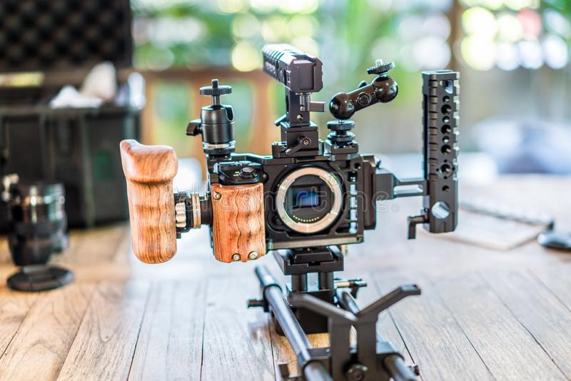 Full Equipment Videography set for Mirrorless small camera for work. Handles, Wooden grip, rod, long lens support, ball head, many attachment area stock images