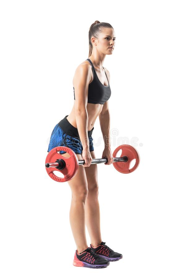 Full extended up position of female athlete doing deadlift exercise with barbell profile. stock images
