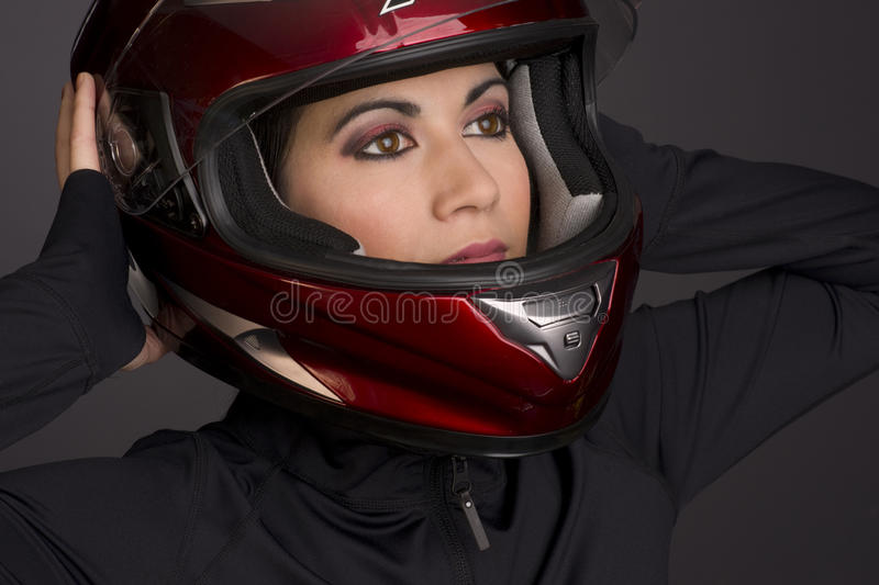 Download Red Full Face Helmet On Attrace Womans Head Stock Image - Image: 22906315