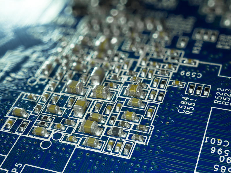 Full focus circuit board with microchips and other electronic components. Computer and networking communication technology royalty free stock image