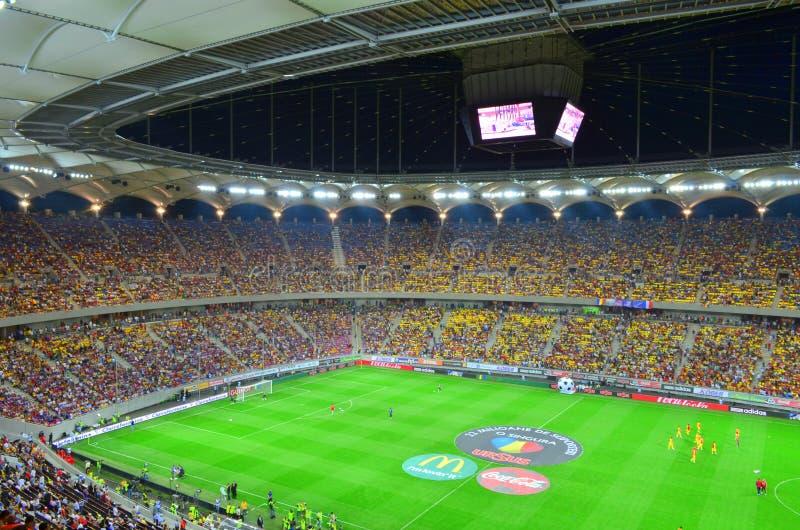 Full fotbollstadion - nationell Arena i Bucharest arkivfoto
