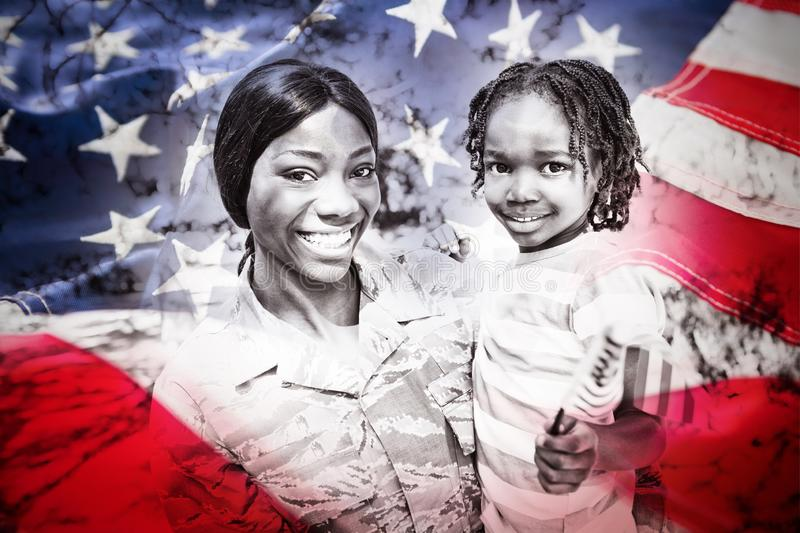 Composite image of full frame of american flag. Full frame of American flag against portrait of happy mother carrying son at park stock images