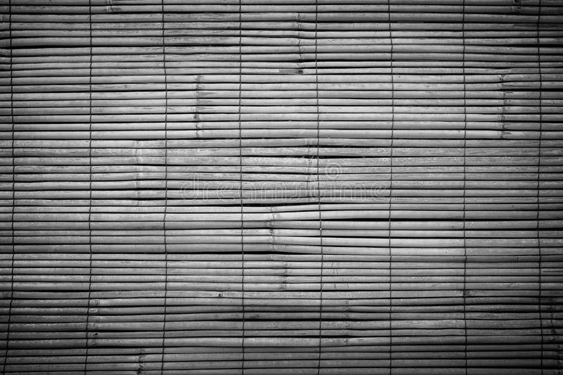 Closeup of faded wooden blinds. Full frame background of aged wooden bamboo blinds in black and white with vignette. They are popular in Asia stock photo