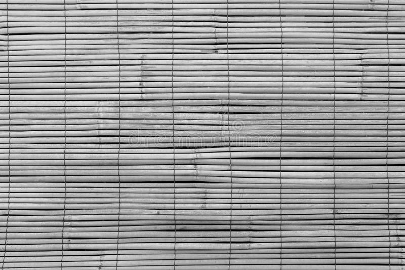 Closeup of faded wooden blinds. Full frame background of aged wooden bamboo blinds, popular in Asia, in black and white stock images