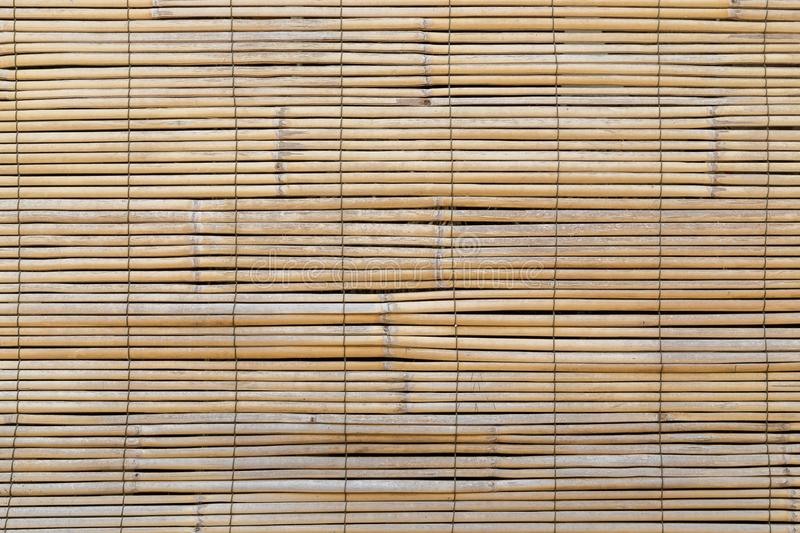 Closeup of faded wooden blinds. Full frame background of aged wooden bamboo blinds, popular in Asia royalty free stock images