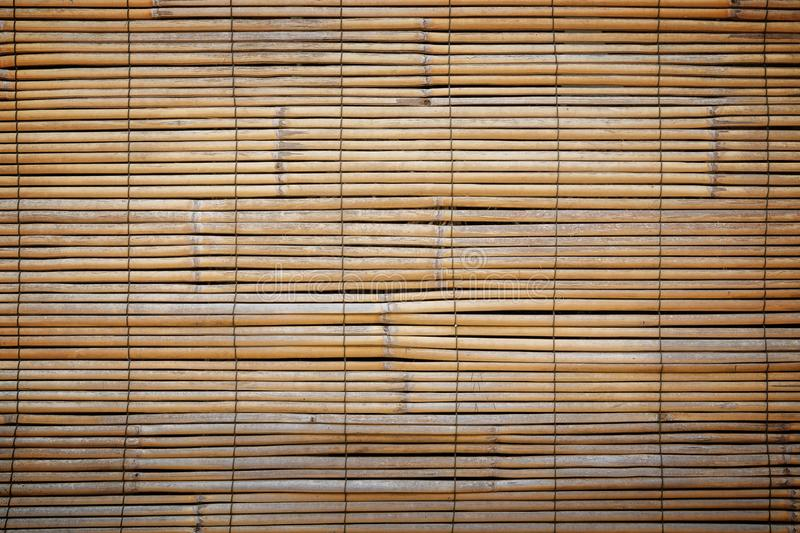 Closeup of faded wooden blinds. Full frame background of aged wooden bamboo blinds with warm tones and vignette. They are popular in Asia royalty free stock photo