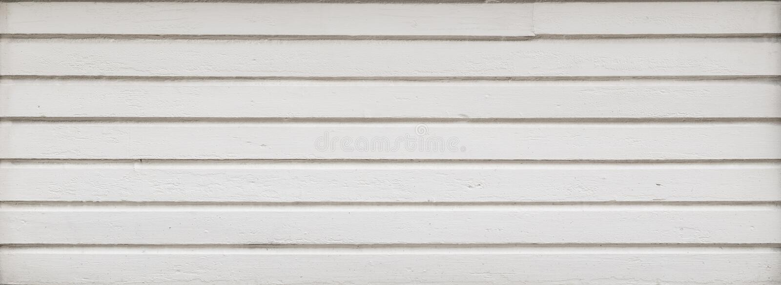 Clean wood board wall in white. Full frame background of a clean wood board wall painted in white. Copy space stock photography