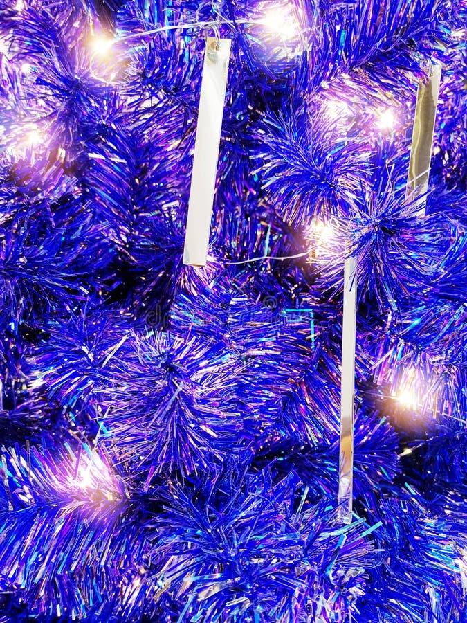 Full Frame Background of Illuminated Blue Purple Christmas Tree Decoration. Full Frame Background of Illuminated Blue Christmas Tree Decoration royalty free stock image