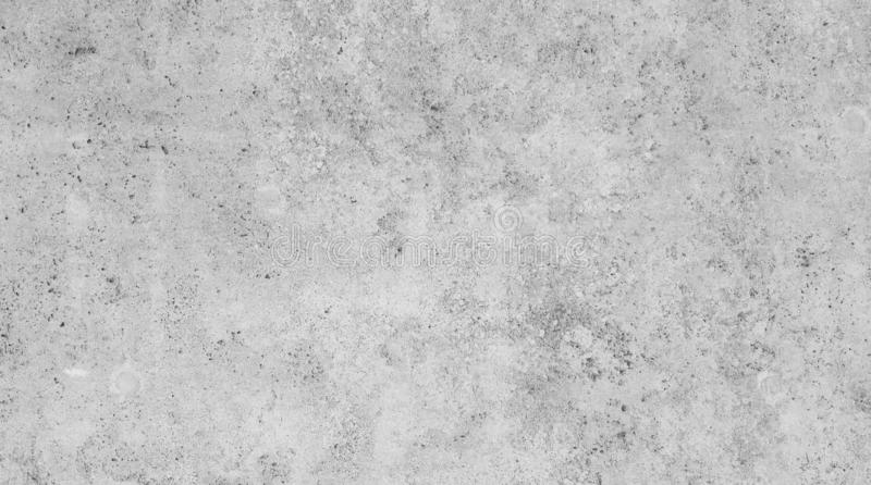 Modern light gray slab wall background. Full frame background of a modern and a bit broken wall or building exterior made of abstract stone slabs in black and royalty free stock photo