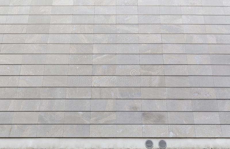 Modern stone wall background. Full frame background of a new, modern and clean stone wall or building exterior royalty free stock photos