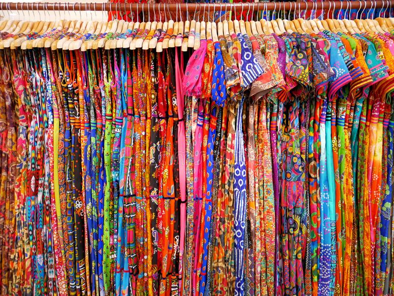 Various Designs of Colorful Women`s Patterned Clothes Hanging on Rack royalty free stock photography