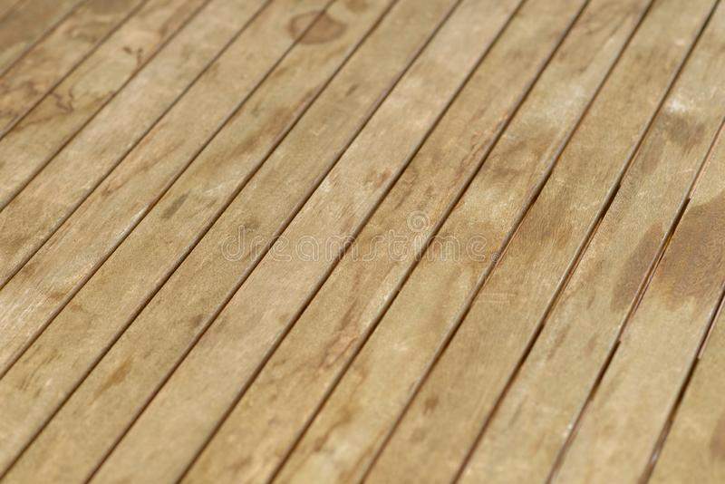 Full frame background of a wooden floor. With the floorboards running diagonally in a high angle view royalty free stock photo