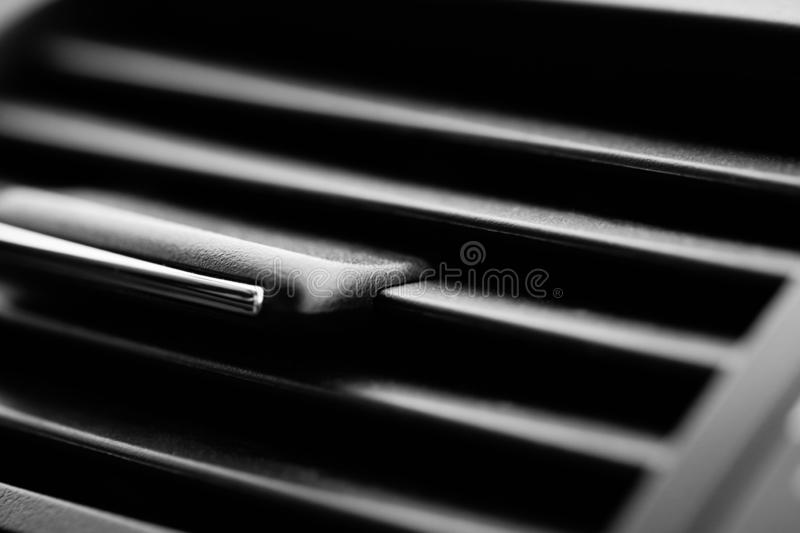 Full frame car interior detail close-up. Automobile still life closeup detail with selective focus. Vehicle air conditioner still royalty free stock image