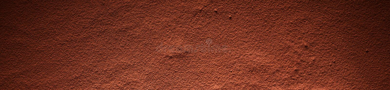 Full frame of cocoa powder surface. Full frame background banner of brown cocoa powder surface with darkened corners royalty free stock photo