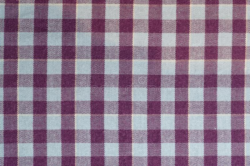Full frame cotton check purple and blue fabric backdrop royalty free stock photos