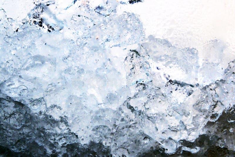 Full frame ice background, frozen water, blue. Black stock image