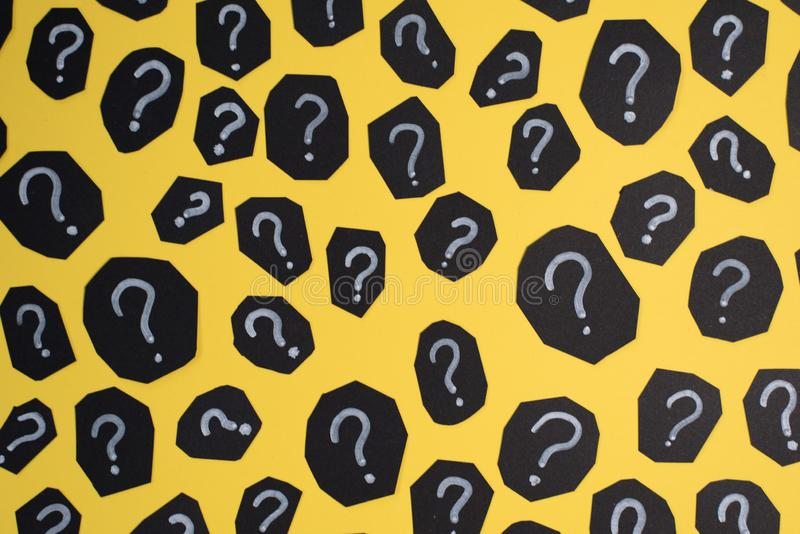 Full frame image of black paper card with QUESTION MARK on yellow background. Concept of FAQ, Q&A, Problems and Questions background stock image