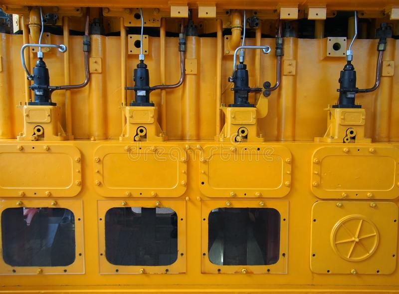 Full frame image of a large yellow diesel engine used as an emergency standby electrical generator. A full frame image of a large yellow diesel engine used as an royalty free stock photography