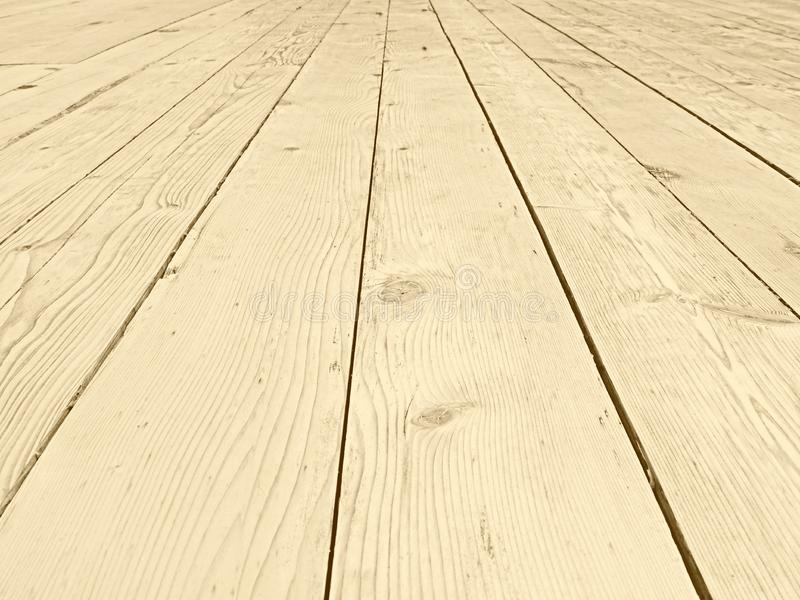 Full frame perspective view of old faded timber planking with a grainy textured surface used for flooring. A full frame perspective view of old faded timber stock photos
