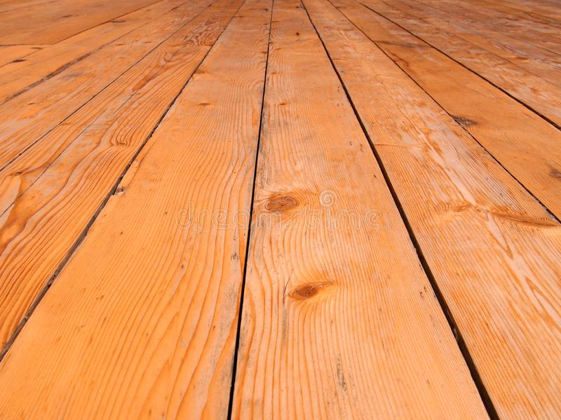 Full frame perspective view of old worn timber planking with a grainy textured surface used for flooring. A full frame perspective view of old worn timber stock photography