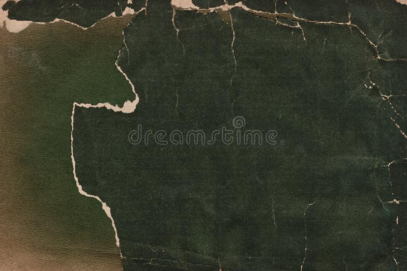 Leather and Fabric Vintage Torn Book Cover. This full frame photograph is of the inside of a dark green leather and fabric book cover. It is torn and dirty stock photography