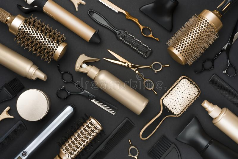 Full frame of professional hair dresser tools on black background royalty free stock photos