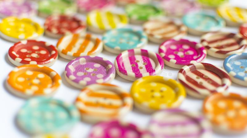 Full frame and selective focus photo of various and colorful sewing buttons.  royalty free stock images