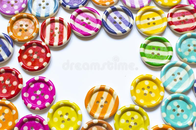 Full frame and selective focus photo of various and colorful sewing buttons.  stock images