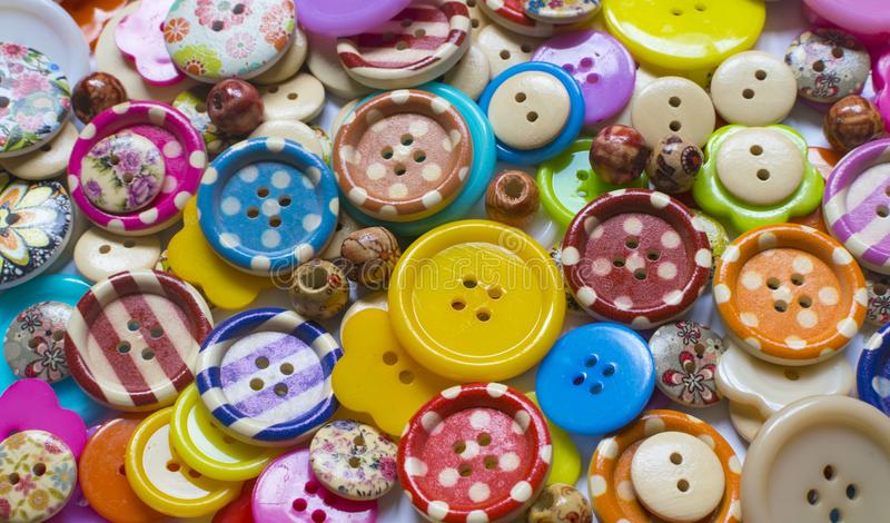 Full frame and selective focus photo of various and colorful sewing buttons.  royalty free stock image