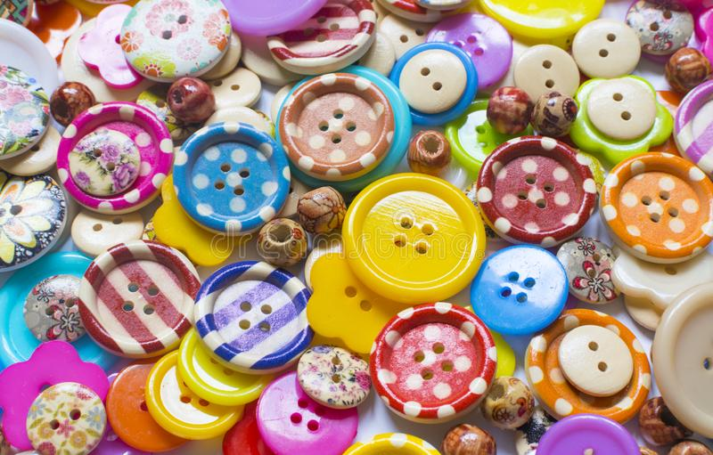 Full frame and selective focus photo of various and colorful sewing buttons.  royalty free stock photos