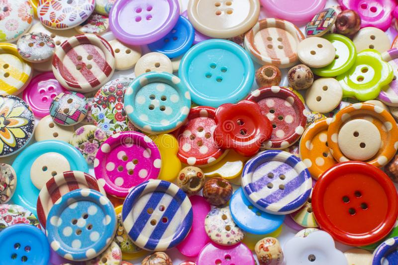 Full frame and selective focus photo of various and colorful sewing buttons.  stock photo
