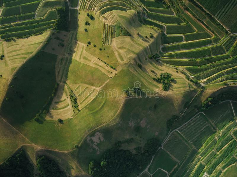 Full frame shot of agricultural fields and hills from bird eye view, europe stock images