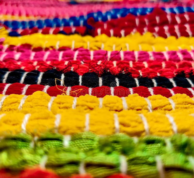 Full frame shot of colorful eye-catching woven threaded fabric stock photos