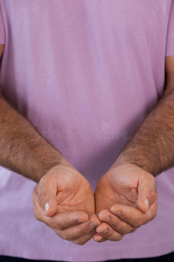Full frame shot of man with hands cupped. Holding invisible product stock photos