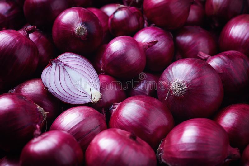 Full Frame Shot Of Purple Onions. Fresh whole purple onions and one sliced onion royalty free stock photography